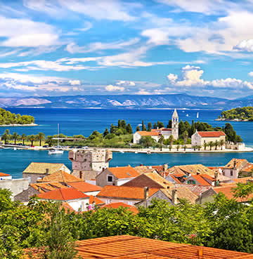 Iconic red-roof settlements pop against the blues of the Adriatic Sea in the Dalmatian Islands
