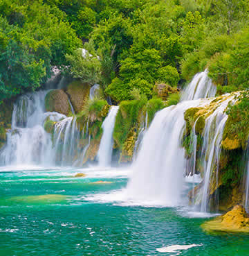 Beautiful Krka waterfalls surrounded by lush greenery