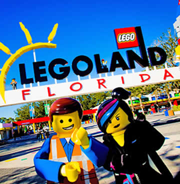 Two LEGO Movie characters in front of the entrance to LEGOLAND Florida