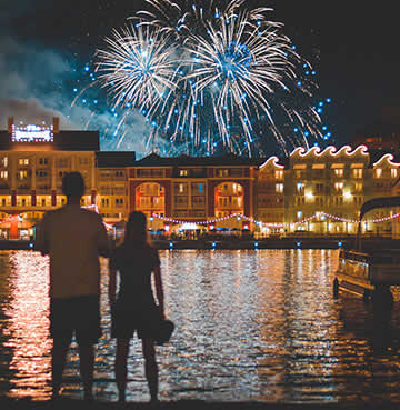 A couple watching a firework display at Walt Disney World, Orlando