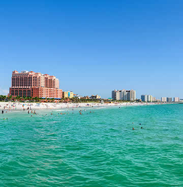 Powder-white sands backed by high-rise skyscrapers at Clearwater Beach on Florida's Gulf Coast