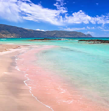 Pink sands and aquamarine waters at Elafonissi Beach, Crete