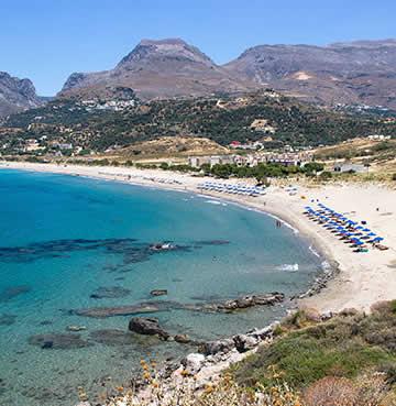 Mountains brood over Plakias Beach, Crete