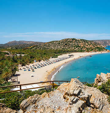 Palm-backed powder-sands of Vai Beach, near Elounda, Crete