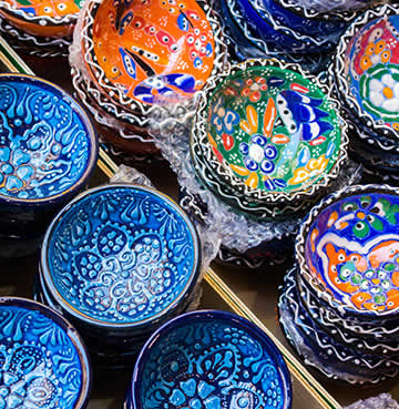 Hand painted, brightly coloured ceramic bowls at a local market