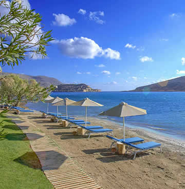 Private beach at the Domes of Elounda Holiday Resort in Crete