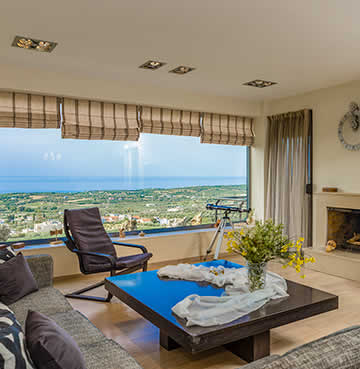 A comfortable lounge area with panoramic views at Villa Artist