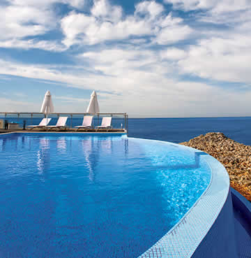 A luxurious infinity pool overlooking the sea in Chania, Crete