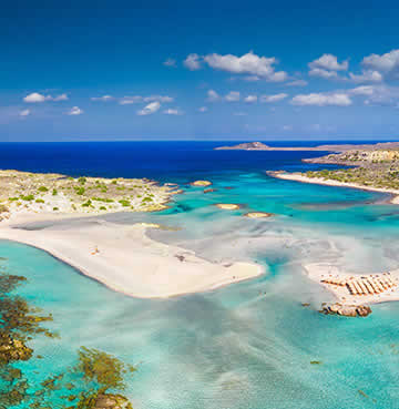 Powder-white sands and lagoonal waters at Elafonissi, Crete