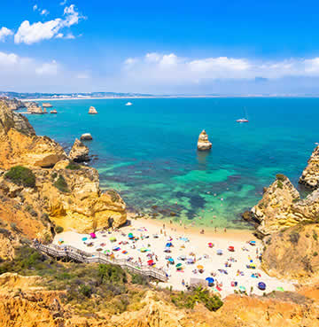 Azure waters and golden, limestone cliffs in Lagos, Algarve