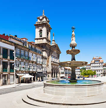 A pretty square in Guimarães, complete with fountain and ornate architecture
