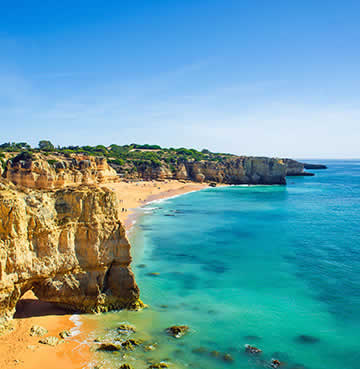 Azure waters and golden sands, backed by soaring limestone cliffs - icons of the Algarve