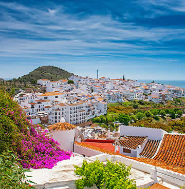 Whitewashed village of Frigiliana, with beautiful bougainvillea draped across red roofs and stunning panoramas out to sea.