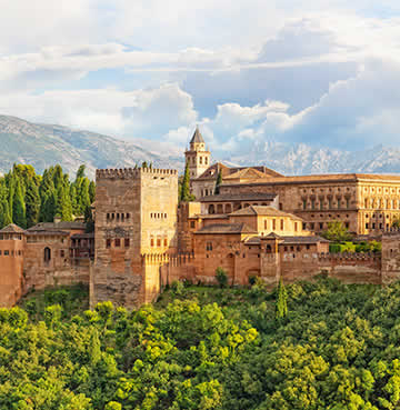 Iconic architecture in Granada, with brooding mountains in the background