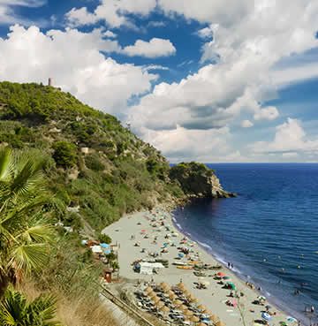 Maro Beach surrounded by cliffs and agricultural land.