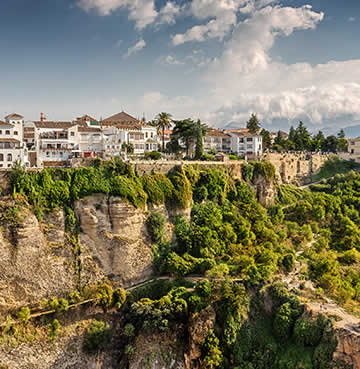The whitewashed village of Ronda perched precariously on the side of El Tajo Gorge.