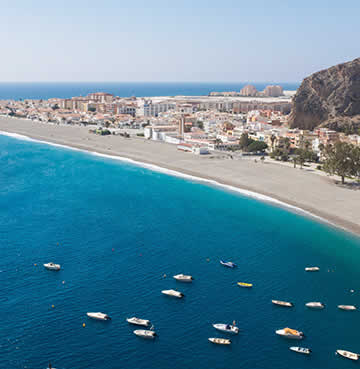Turquoise seas lap against golden shores in Calahonda on the Costa del Sol