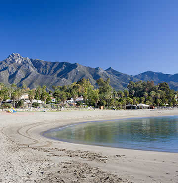 Mountain-flanked beach in Marbella