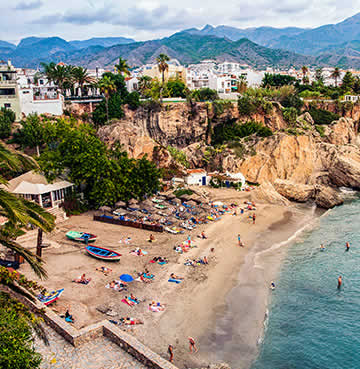 Bronzed beaches and mountainous backdrop at the fishing village of Nerja.