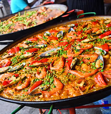 Traditional paella in a large pan, ready for serving.