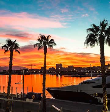 Modern marina at sunset in Malaga