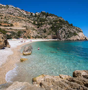 Crystal-clear waters and rocky headlands on the Costa Blanca favourite, Playa la Granadella