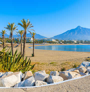 Golden sands, rocky breakwaters, brooding mountains and breeze-swept palm trees make up the views on Marbella's first-class beaches