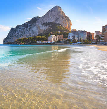 Turquoise waters of La Fossa Beach, Costa Blanca. The iconic Peñón de Ifach sits in the background