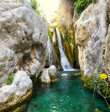 Tranquil, turquoise Algar Waterfall in Costa Blanca