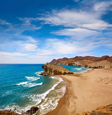Arid sands and volcanic rock formations at Cabo de Gata, Almeria