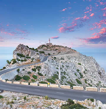 A winding road weaves to the lighthouse at the end of the Cap de Formentor peninsula