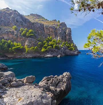 Startling blue waters at Sa Calobra beach, Mallorca