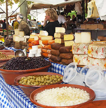 A local Mallorca market, selling a variety of fresh produce and cooking ingredients