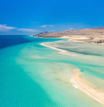 Azure waters and powder-white sands of the iconic Fuerteventura beaches