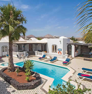 Traditional, whitewashed villa with a tiled courtyard and large, private pool.