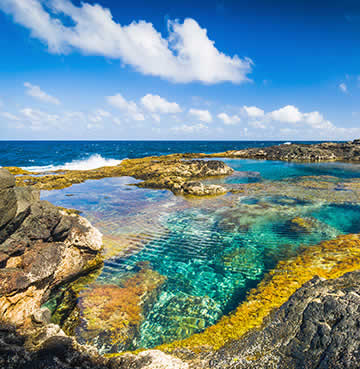 Volcanic rocks have created natural seawater pools on the Lanzarote coastline