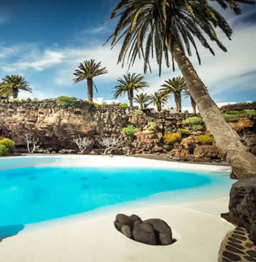 Taro de Tahiche and it's aquamarine water pools and swaying palm trees, all set into volcanic rock