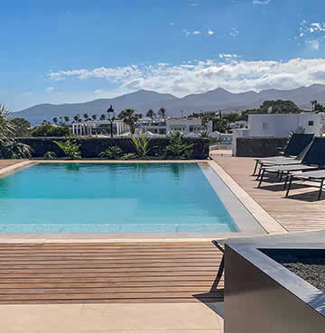 A private swimming pool and luxury decking are watched over by the soaring mountains of Lanzarote