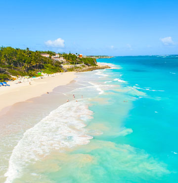 Aerial shot of azure waters lapping against powder sands at the Crane Beach, Barbados