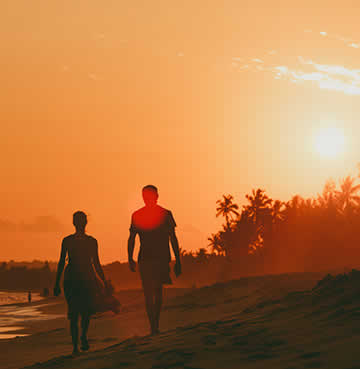 Couple taking a walk at sunset on a tropical beach in the Caribbean