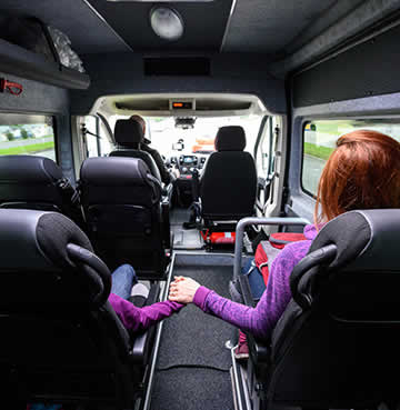 Family sitting in private transfer minibus