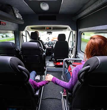 Family sitting in private transfer minibus