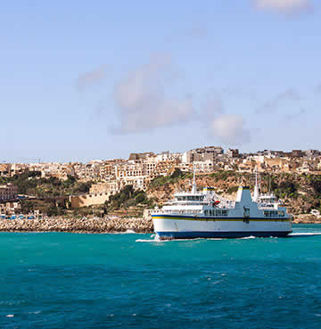 Image showing a ferry in the bay of a Dalmatian Island. The island is in the background with blue skies above.