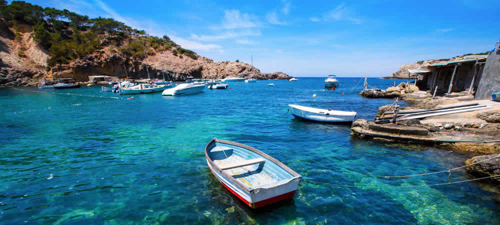 A bay in Ibiza with little fishing boats
