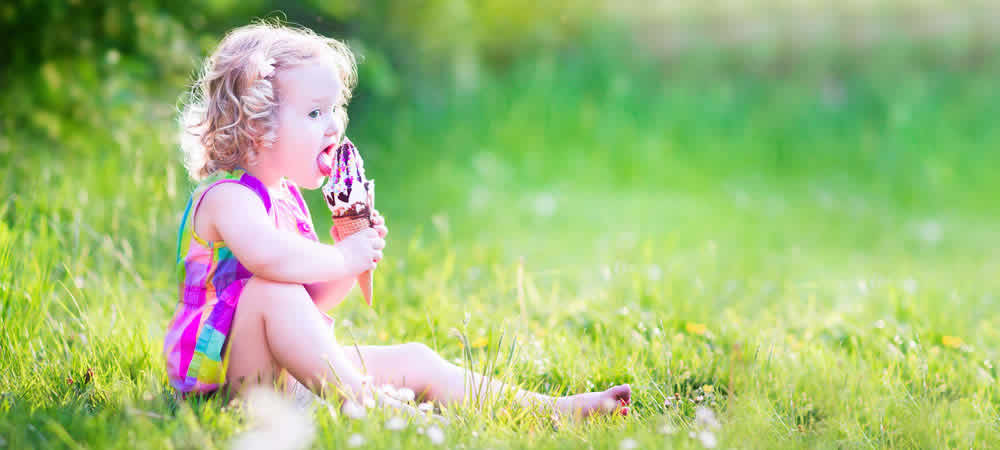 A little girl eating her Italian gelato