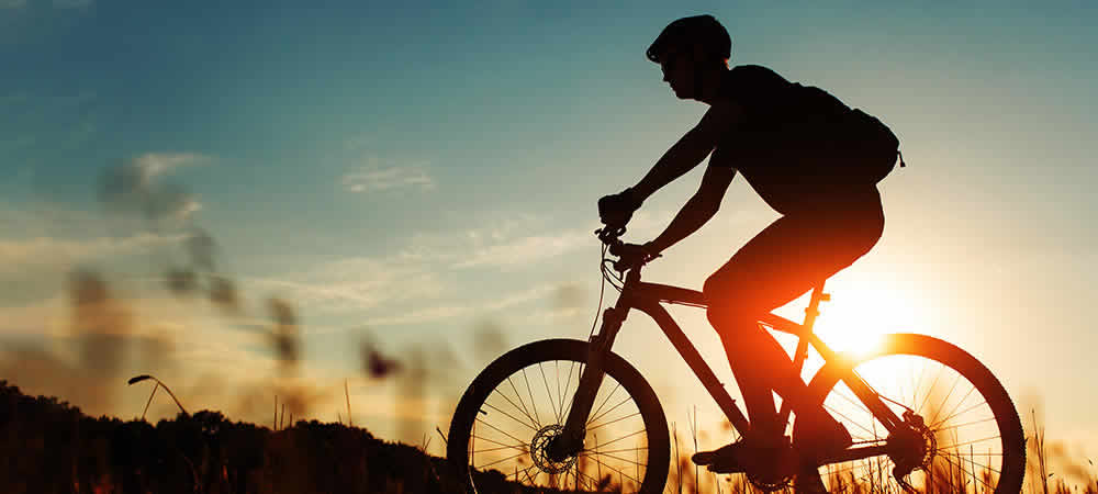 A person mountain biking at sunset in Malta