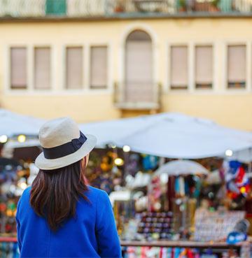 Woman looking towards market in Italy