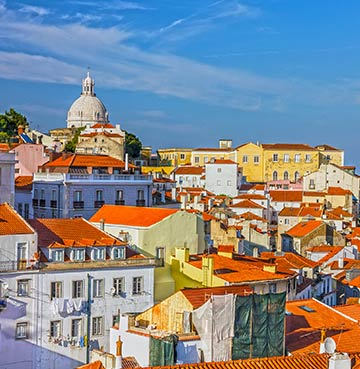 Lisbon skyline with colourful building and Cathedral dome, Portugal