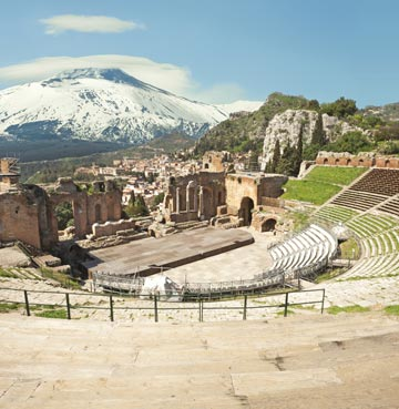 The ancient theatre of Taormina, looking out towards Mount Etna on Sicily