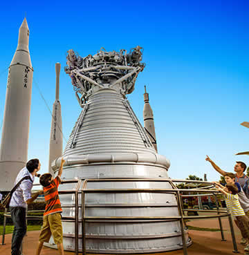 A family gathers round a real space rocket at Kennedy Space Center Visitor Complex, Florida